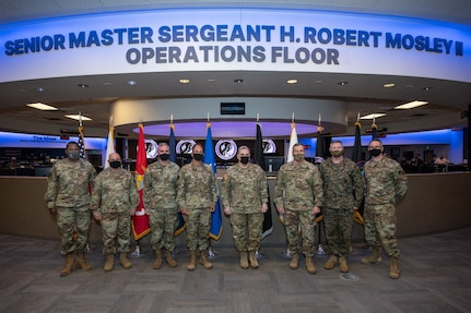 military leaders stand in a room