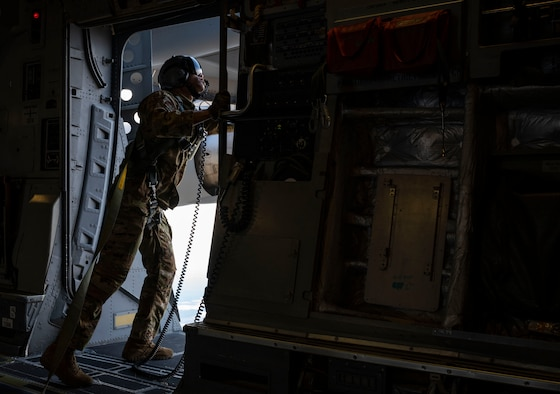 Senior Airman Keoni Gibson, 8th Airlift Squadron loadmaster, checks the perimeter of a door on a C-17 Globemaster III assigned to the 62nd Airlift Wing, Joint Base Lewis-McChord, Wash., prior to a static-line jump during Exercise Predictable Iron at Pope Army Airfield, Fort Bragg, N.C., Feb. 25, 2021. The exercise provided the opportunity for the U.S. Air Force and U.S. Army to strengthen their skill sets together and accomplish the Department of Defense's mission to provide combat-credible military forces.