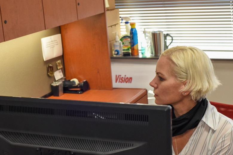 Shallyn Troutman in her office, improving a process.