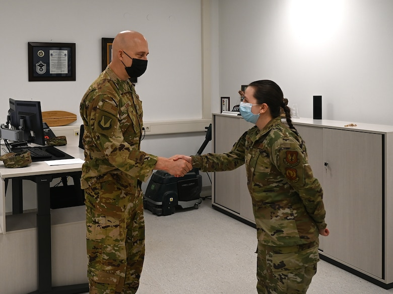 U.S. Air Force Brig. Gen. Joshua Olson, 86th Airlift Wing commander, left, coins Airman 1st Class Mariia Shevchenko, 86th Maintenance Squadron precision measurement equipment laboratory apprentice, during an Airlifter of the Week ceremony