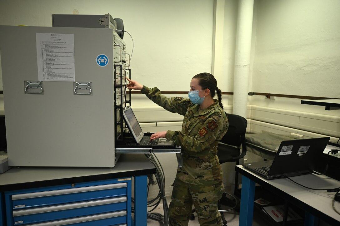 U.S. Air Force Airman 1st Class Mariia Shevchenko, 86th Maintenance Squadron precision measurement equipment laboratory apprentice, runs calibration testing on a laptop at a PMEL facility