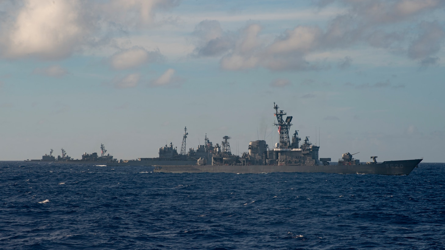 PACIFIC OCEAN (Feb. 28, 2021) – The Japan Maritime Self-Defense Force (JMSDF) Hatakaze-class destroyer JDS Hatakaze (TV 3520), front, Ticonderoga-class guided-missile cruiser USS Bunker Hill (CG 52), center, JMSDF Hatsuyuki-class destroyer JDS Setoyuki (TV 3518), left, and JMSDF Asagiri-class destroyer JDS Yugiri (DD 153) transit the Pacific Ocean Feb. 28, 2021. Bunker Hill, part of the Theodore Roosevelt Carrier Strike Group, is on a scheduled deployment to the U.S. 7th Fleet area of operations. As the U.S. Navy's largest forward-deployed fleet, 7th Fleet routinely operates and interacts with 35 maritime nations while conducting missions to preserve and protect a free and open Indo-Pacific Region. (U.S. Navy photo by Mass Communication Specialist 3rd Class Erik Melgar)