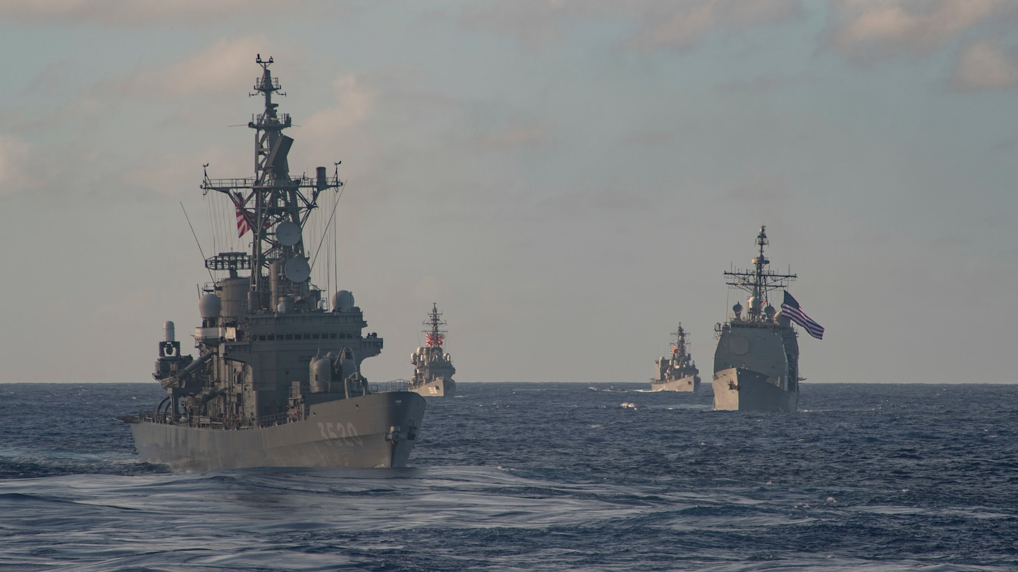 PACIFIC OCEAN (Feb. 28, 2021) – The Japan Maritime Self-Defense Force (JMSDF) Hatakaze-class destroyer JDS Hatakaze (TV 3520), front, Ticonderoga-class guided-missile cruiser USS Bunker Hill (CG 52), far right, JMSDF Hatsuyuki-class destroyer JDS Setoyuki (TV 3518), left, and JMSDF Asagiri-class destroyer JDS Yugiri (DD 153) transit the Pacific Ocean Feb. 28, 2021. Bunker Hill, part of the Theodore Roosevelt Carrier Strike Group, is on a scheduled deployment to the U.S. 7th Fleet area of operations. As the U.S. Navy's largest forward-deployed fleet, 7th Fleet routinely operates and interacts with 35 maritime nations while conducting missions to preserve and protect a free and open Indo-Pacific Region. (U.S. Navy photo by Mass Communication Specialist 3rd Class Erik Melgar