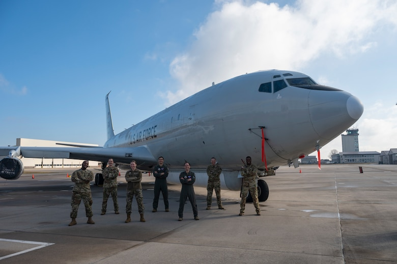 U.S. Air Force, U.S. Army and U.S. Space Force aircrew and support members from the 10th Expeditionary Airborne Command and Control Squadron pose for a group photo in front of their E-8C Joint STARS aircraft during a Combine Joint All-Domain Command and Control demonstration at Ramstein Air Base, Germany, Feb. 27, 2021.