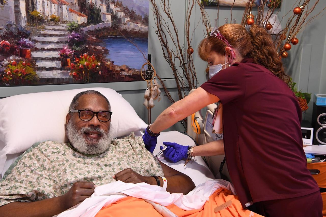 A man in a nursing home receives a vaccine.