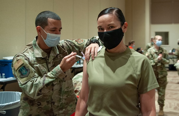 Chief Master Sergeant Billie M. Baber, Headquarters Air Reserve Personnel Center command chief, receives her first dose of the COVID-19 vaccination
