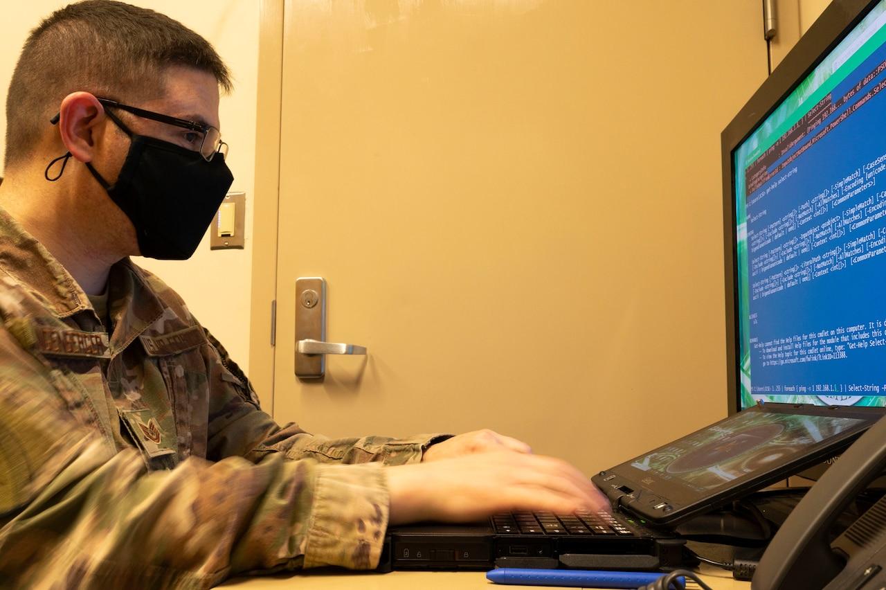 A man operates a computer.
