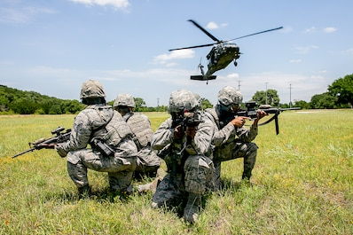 147th Security forces prepare to board a UH-60 Blackhawk