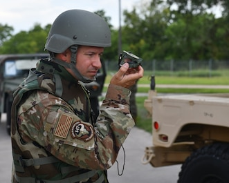 CE Airman uses a compass during an exercise