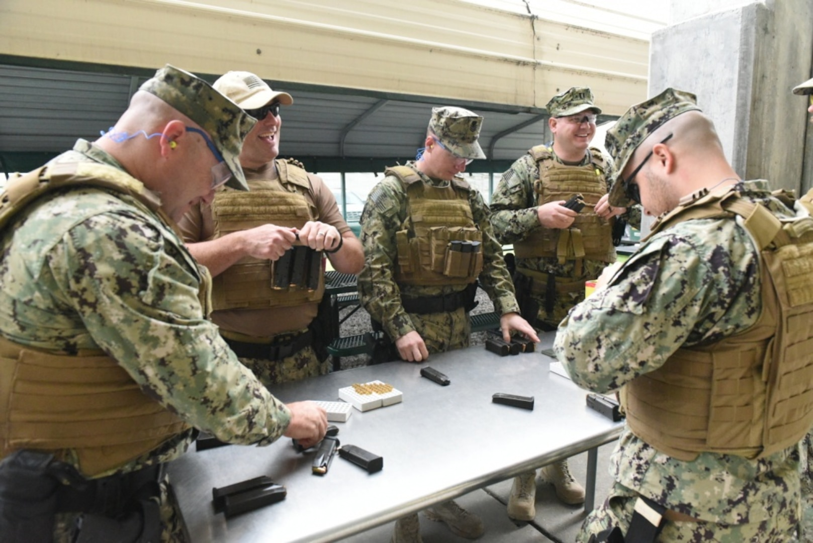 Coast Guard members with Port Security Unit 307 load magazines before completing weapons training at Pinellas County Sheriff's Office firing range in Clearwater, Florida, Nov. 16, 2019. Members with the Clearwater-based unit conduct training to maintain readiness in order to deploy anywhere in the world within 96 hours. U.S. Coast Guard photo by Petty Officer 2nd Class Ashley J. Johnson.
