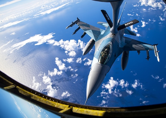 A U.S. Air Force F-16 Fighting Falcon assigned to the 18th Aggressor Squadron conducts an aerial refueling with a U.S. Air Force KC-135 Stratotanker during exercise Cope North 21 near Andersen Air Force Base, Guam, Feb. 18, 2021. (U.S. Air Force photo by Senior Airman Duncan C. Bevan)