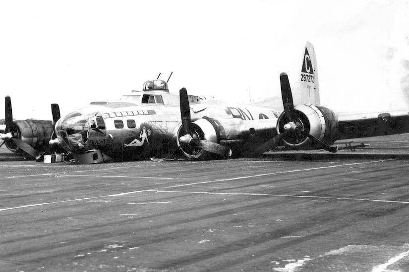 A damaged plane lies on the tarmac.