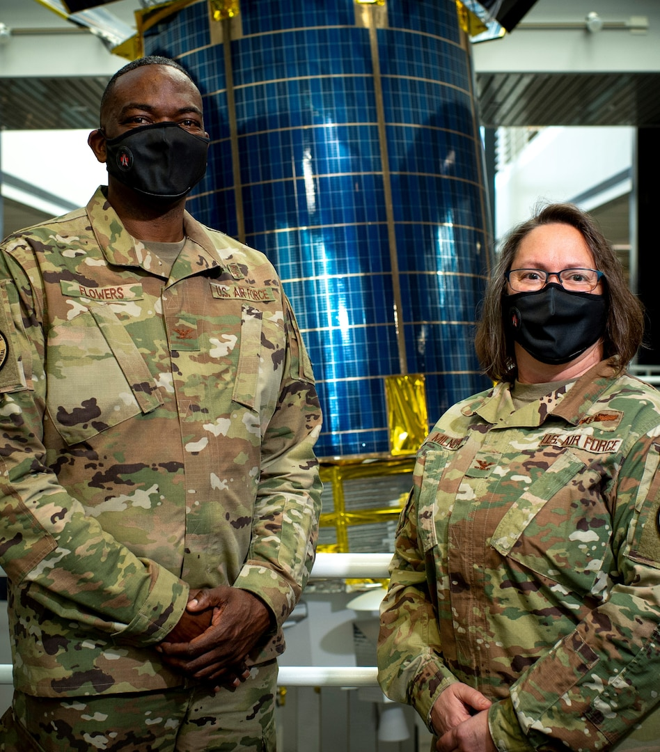 Image of two Airmen posing for the camera.