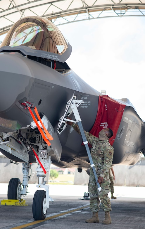 U.S. Air Force Staff Sgt. Roger Remoket opens the canopy of an F-35 Lightning II during Exercise Cope North 21 at Andersen Air Force Base, Guam, Feb. 13, 2021.