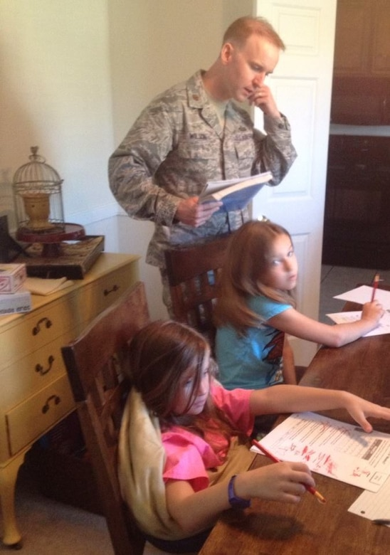 Father teaches girls during his lunch break before heading back to work.