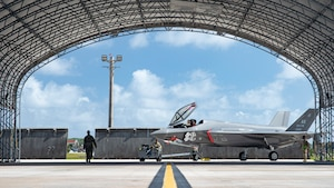U.S. Air Force Staff Sgt. Roger Remoket tows an F-35 Lightning II at Andersen Air Force Base, Guam, Feb. 23, 2021.
