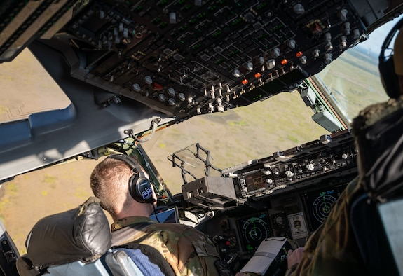 First Lt. August Hein (left), and Capt. Reed Fleming, both 3rd Airlift Squadron pilots, fly a C-17 Globemaster III over Florida during exercise Mosaic Tiger Feb. 25, 2021. Airmen from Dover AFB and Joint Base McGuire-Dix Lakehurst, New Jersey participated in the exercise, led by the 23rd Wing at Moody AFB, Georgia. The exercise tested agile combat employment, across multiple major commands, to build mission-essential skills. (U.S. Air Force photo by Airman 1st Class Faith Schaefer)
