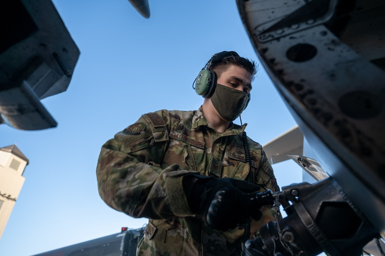 Staff Sgt. Timothy Clayton-Cornell, 736th Aircraft Maintenance Squadron crew chief, Dover Air Force Base, Delaware, attaches a fuel hose to a Dover AFB C-17 Globemaster III during Exercise Mosaic Tiger at Moody AFB, Georgia, Feb. 25, 2021. Airmen from Dover AFB participated in the exercise, testing simulated downrange capabilities to build mission-essential skills to support the needs of Air Combat Command and Air Mobility Command. (U.S. Air Force photo by Airman 1st Class Faith Schaefer)