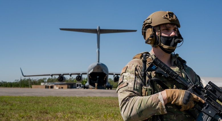 Staff Sgt. Matthew Snipes, 23rd Security Forces Squadron resource advisor, Moody Air Force Base, Georgia, guards a Dover AFB C-17 Globemaster III during Exercise Mosaic Tiger, at Avon Park Air Force Range, Florida, Feb. 23, 2021. Mosaic Tiger is an agile combat employment exercise designed to test multi-capable Airmen integrating mission-essential skills with minimal resources, so Airmen can continue to support combat operations. (U.S. Air Force photo by Airman 1st Class Faith Schaefer)