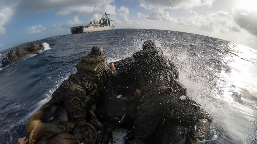 U.S. Marines navigate through water on a combat rubber raiding craft during a boat launch near Peleliu in the Philippine Sea, March 1, 2021.