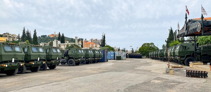 FMTV trucks stage at a Lebanese Armed Forces location in Beirut, Lebanon, after the Army Security Assistance Enterprise overcame pandemic restrictions, quality control and logistical challenges, to deliver ahead of schedule, 31 FMTV trucks to Lebanese Armed Forces.