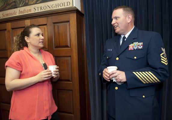 U.S. Coast Guard Academy Sexual Assault Response Coordinator Shannon Norenburg speaks with Chief Petty Officer Todd Lonergan during a Sexual Assault Response and Prevention meeting April 3, 2013, at the U.S. Coast Guard Academy in New London, Conn. The chiefs came together to unite against sexual assault at the academy and had the opportunity to hear from the academy's sexual assault response coordinator and superintendent of the academy. (U.S. Coast Guard photograph by Petty Officer 3rd Class Diana Honings/RELEASED)