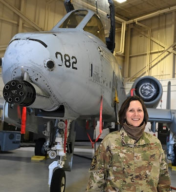 U.S. Air Force Master Sgt. Linda Musto, 175th Maintenance Squadron first sergeant, stands in front of an A-10C Thunderbolt II aircraft at Warfield Air National Guard Base at Martin State Airport, Baltimore, Md., March 2, 2021. Musto was an aircraft armament systems mechanic before her current role. (U.S. Air National Guard photo by Master Sgt. Christopher Schepers)