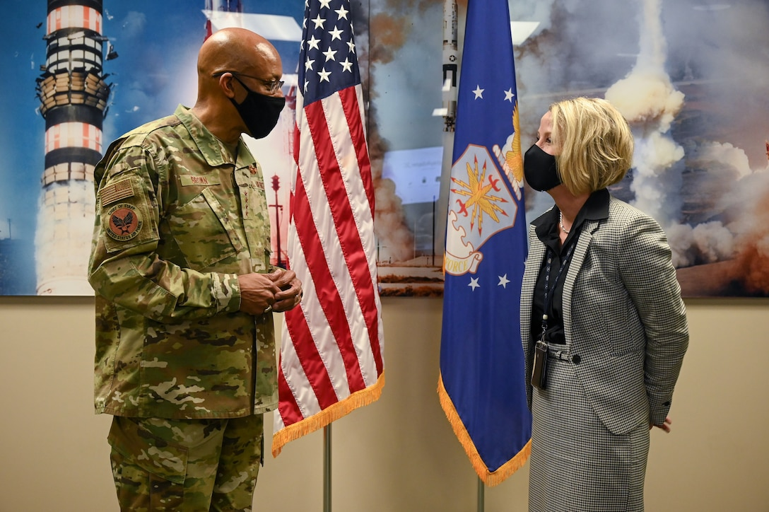 Air Force Chief of Staff Gen. Charles Q. Brown, Jr. speaks with Jarie MIckelson, GBSD deputy system program manager, before presenting her with a coin during a visit to Hill Air Force Base, Utah, March 2, 2021.