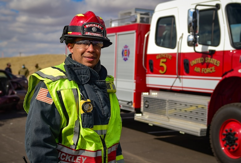 Fire Lt. Isaiah C. Draper, a firefighter with the 460th Civil Engineer Squadron, poses in front of the new Heavy Rescue truck before an auto extraction exercise on Buckley Air Force Base, Colo., Feb. 24, 2021.