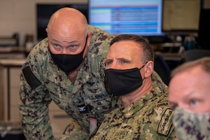 Vice Adm. William Galinis, commander, Naval Sea Systems Command, receives a brief