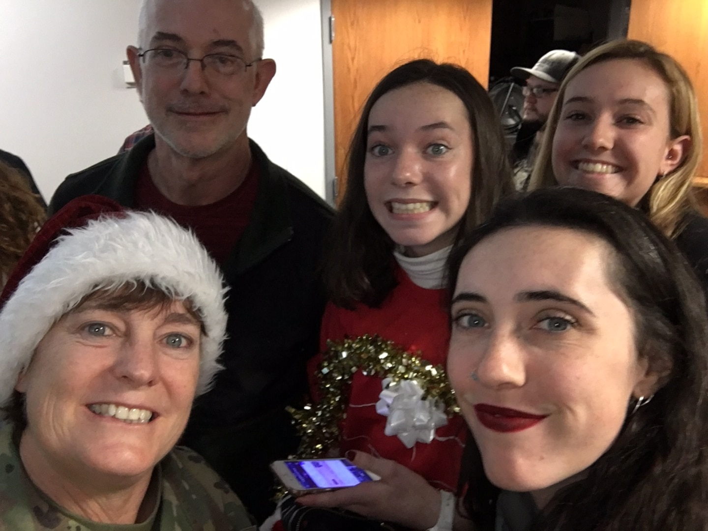 Brig. Gen. Michelle Rose (left) poses with her family during the 2019 holiday season.