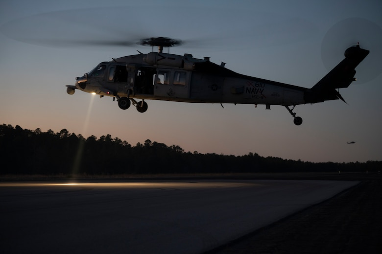 A U.S. Navy MH-60 Seahawk Helicopter, assigned to Helicopter Sea Combat Squadron 9, prepares to land at a forward area refueling point during Emerald Warrior 21.1, at Hurlburt Field, Florida, Feb. 20, 2021. Emerald Warrior is the largest joint special operations exercise involving U.S. Special Operations Command forces training to respond to various threats across the spectrum of conflict. Exercises like EW give theater commanders the assurance SOF forces can respond quickly — on time, every time. (U.S. Air Force photo by Senior Airman Edward Coddington)