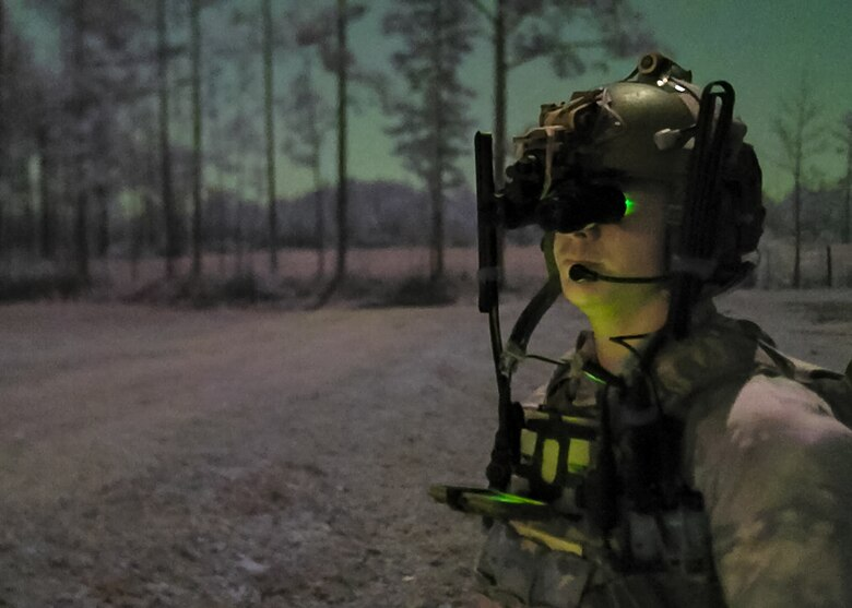 A U.S. Air Force Special Tactics operator assigned to the 24th Special Operations Wing surveys an exercise mission zone during Emerald Warrior 21.1, Feb. 22, 2021, at Camp Shelby, Mississippi. Emerald Warrior is the largest joint special operations exercise involving U.S. Special Operations Command forces training to respond to various threats across the spectrum of conflict. (U.S. Air Force photo by Staff Sgt. Gabriel Macdonald)