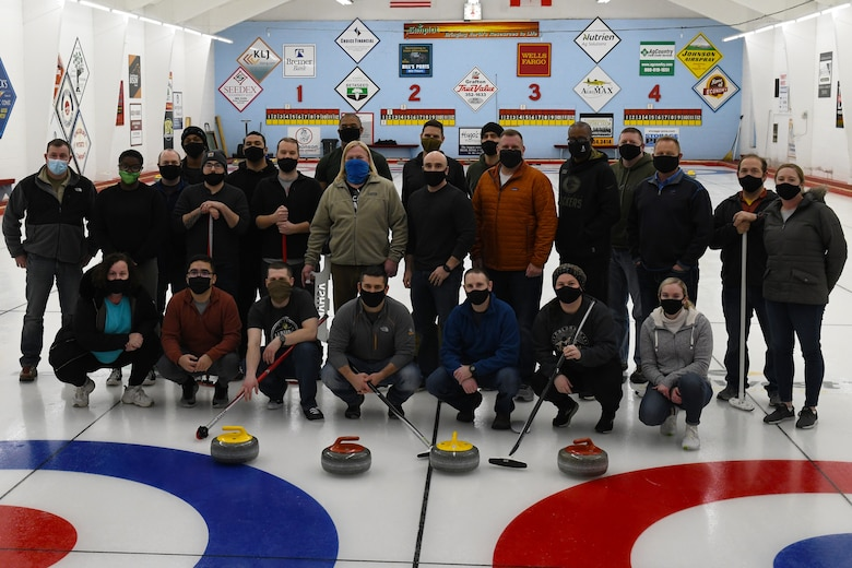 U.S. Space Force Space Delta 4 leadership and members from the 10th Space Warning Squadron team join together and visit the base's local curling club at Grafton, N.D., Feb. 22, 2021. The team was taught different curling techniques and learned the local curling club's history. (U.S. Space Force photo by Airman 1st Class Andrew Garavito)