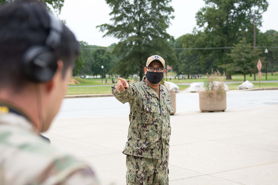 Students and instructors conduct camera training outside the Defense Information School.
