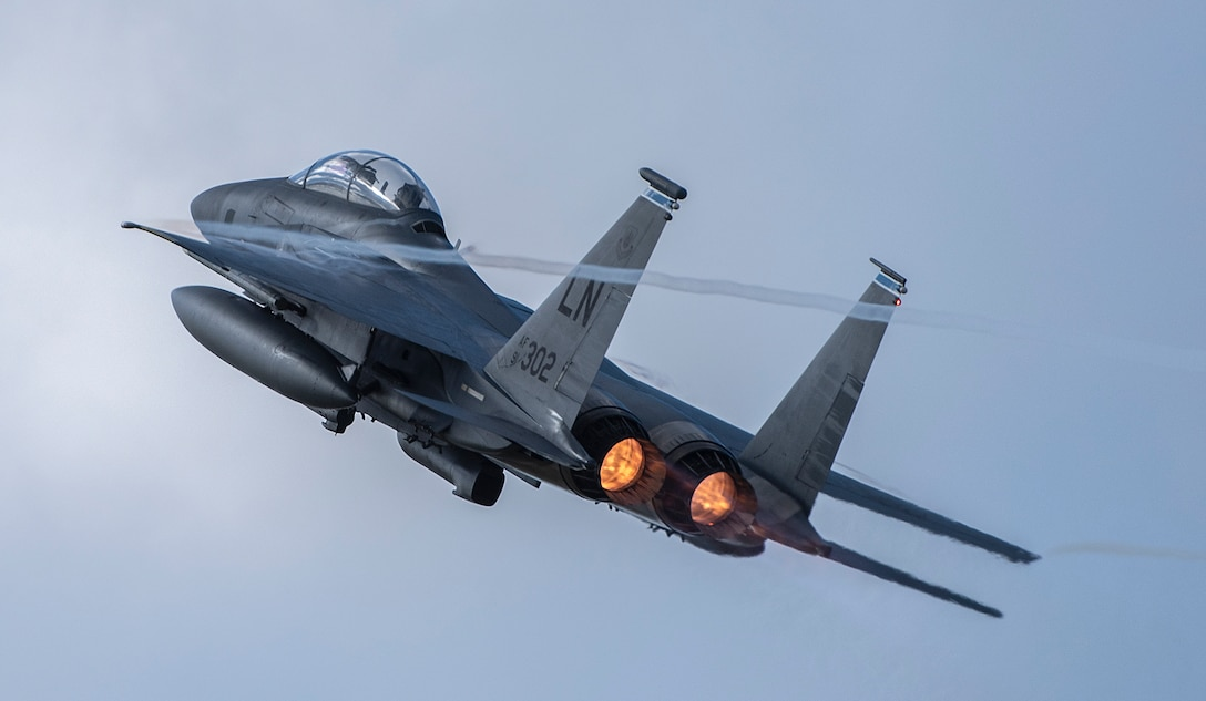 An F-15E Strike Eagle assigned to the 492nd Fighter Squadron takes off for an orientation flight at Royal Air Force Lakenheath, England, Feb. 26, 2021. Orientation flights are offered to those who have responsibilities related to aviation and aircraft or as an award to individuals who show exceptional performance in their duties. (U.S. Air Force photo by Airman 1st Class Jessi Monte)