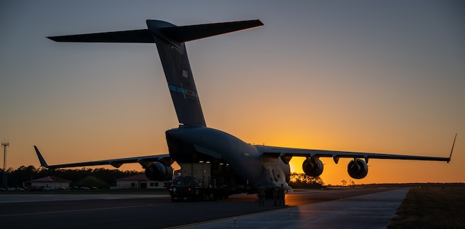 Cargo is loaded onto a Dover Air Force Base C-17 Globemaster III during exercise Mosaic Tiger at MacDill AFB, Florida, Feb. 25, 2021. Airmen from four different bases, representing two major commands, participated in the exercise that included multiple Air and Space Force installations. (U.S. Air Force photo by Airman 1st Class Faith Schaefer)