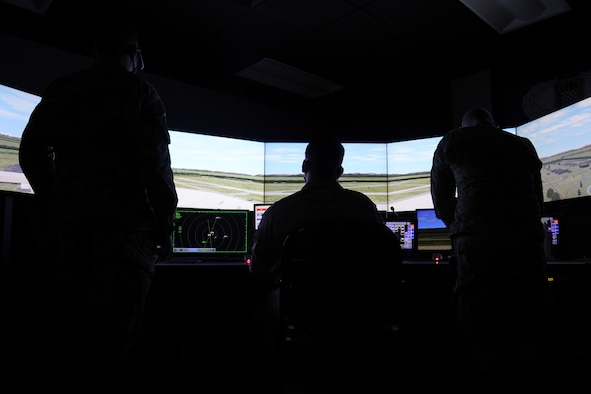 U.S. Air Force Tech. Sgt. Dustin Brannan, 334th Training Squadron air traffic control instructor, practices air traffic simulations inside Cody Hall at Keesler Air Force, Mississippi, March 4, 2020. Brannan was selected to be a part of the Air Education and Training Command Air Traffic Control Rapid Response Team, initiated to combat the potential loss of manning due to COVID-19. (U.S. Air Force photo by Senior Airman Seth Haddix)
