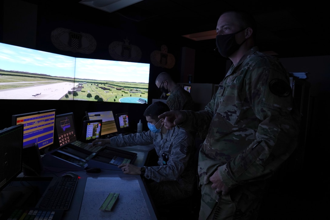 U.S. Air Force Tech. Sgts. Dereck Padgett, Kyle Hayes, and Dustin Brannan, 334th Training Squadron air traffic control instructors, practice air traffic simulations inside Cody Hall at Keesler Air Force, Mississippi, March 4, 2020. The instructors were selected to be a part of the Air Education and Training Command Air Traffic Control Rapid Response Team, initiated to combat the potential loss of manning due to COVID-19. (U.S. Air Force photo by Senior Airman Seth Haddix)