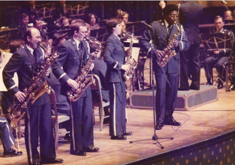 """The sax section joins soloist Chief Master Sgt. James Scott at the front of the stage during a performance of Jerry Bilik's """"Rhapsody & Variations"""" at Constitution Hall in 1980."""