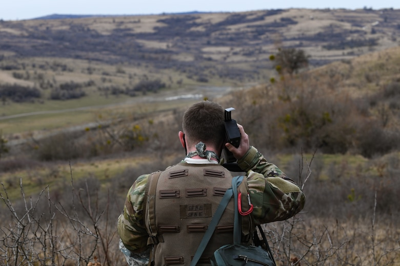 U.S. Air Force Capt. Austin Huff, 510th Fighter Squadron F-16 Fighting Falcon pilot, listens to his radio during Operation Porcupine in Romania, March 4, 2021.