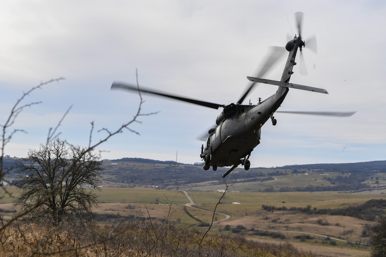 A U.S. Air Force HH-60G Pave Hawk helicopter takes off after rescuing a downed pilot during Operation Porcupine in Romania, March 4, 2021.