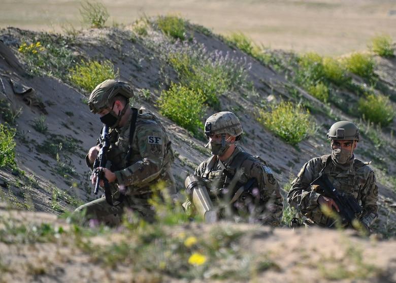 A photo of Airmen securing a scene