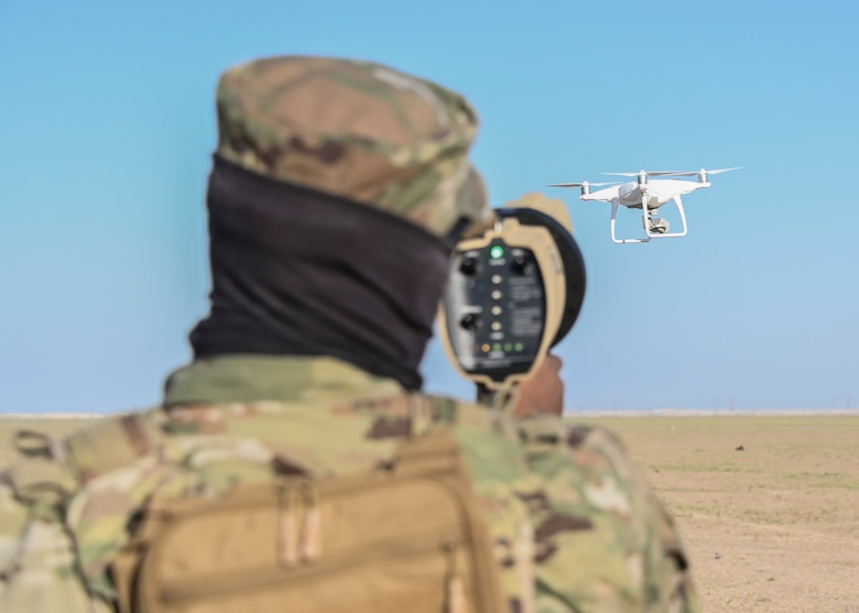 A photo of an Airman and a drone