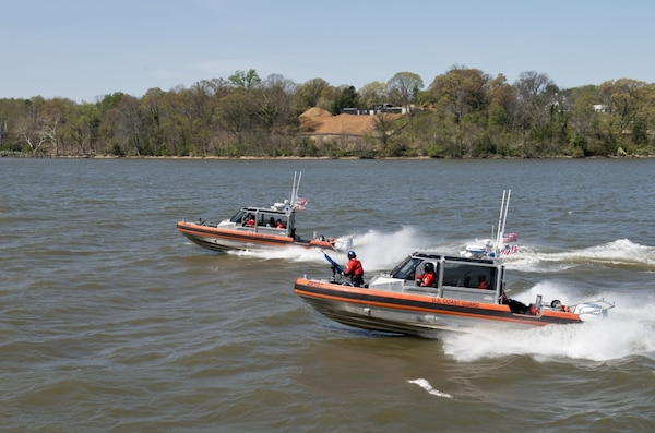 Boat crews from Coast Guard Station Washington aboard two 29-foot Response Boat-Smalls train in the Potomac River near Alexandria, Virginia, Thursday Apr. 6, 2016. Boat crews train to remain proficient in their skills and abilities. (U.S. Coast Guard photo by Petty Officer 3rd Class Jasmine Mieszala)