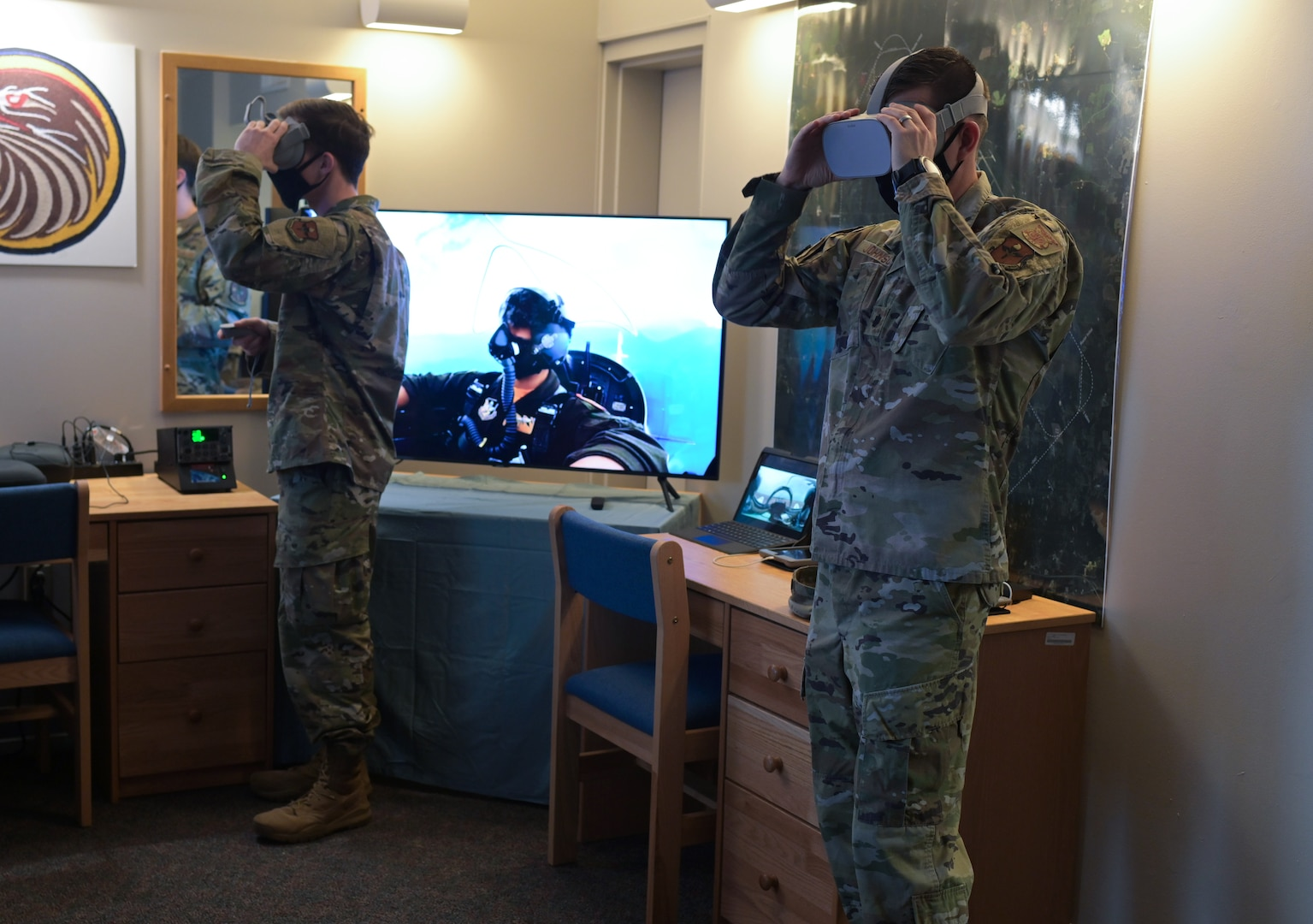 U.S. Air Force Lt. Col. Tyler Johnson, 14th Civil Engineer Squadron commander (Right), and 2nd Lt. Connor Spencer, 14th Student Squadron student pilot, test out a virtual reality training system recently installed for student pilots, Feb. 12, 2021, on Columbus Air Force Base, Miss. Student pilots assigned to the Specialized Undergraduate Pilot Training program will have 24 hour access to the training resources as part of the first step in a long term innovation and resource utilization plan. (U.S. Air Force photo by Senior Airman Jake Jacobsen)