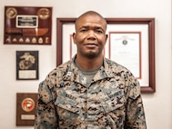 U.S. Marine Corps Capt. Gabra A. Bailey, a supply officer with 12th Marine Corps District, poses in his office at the district headquarters located at Marine Corps Recruit Depot San Diego on March 4, 2021. Bailey was born and raised in Kingston, Jamaica before immigrating to the United States and becoming a Marine. (U.S. Marine Corps photo by Sgt. Tessa D. Watts)