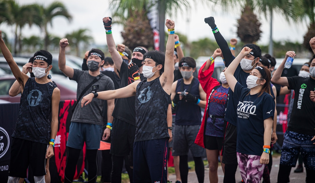 Contestants participating in the Okinawa Spartan Race motivate each other before beginning the race on Chura Sun Beach, Okinawa, Japan, Feb. 27.
