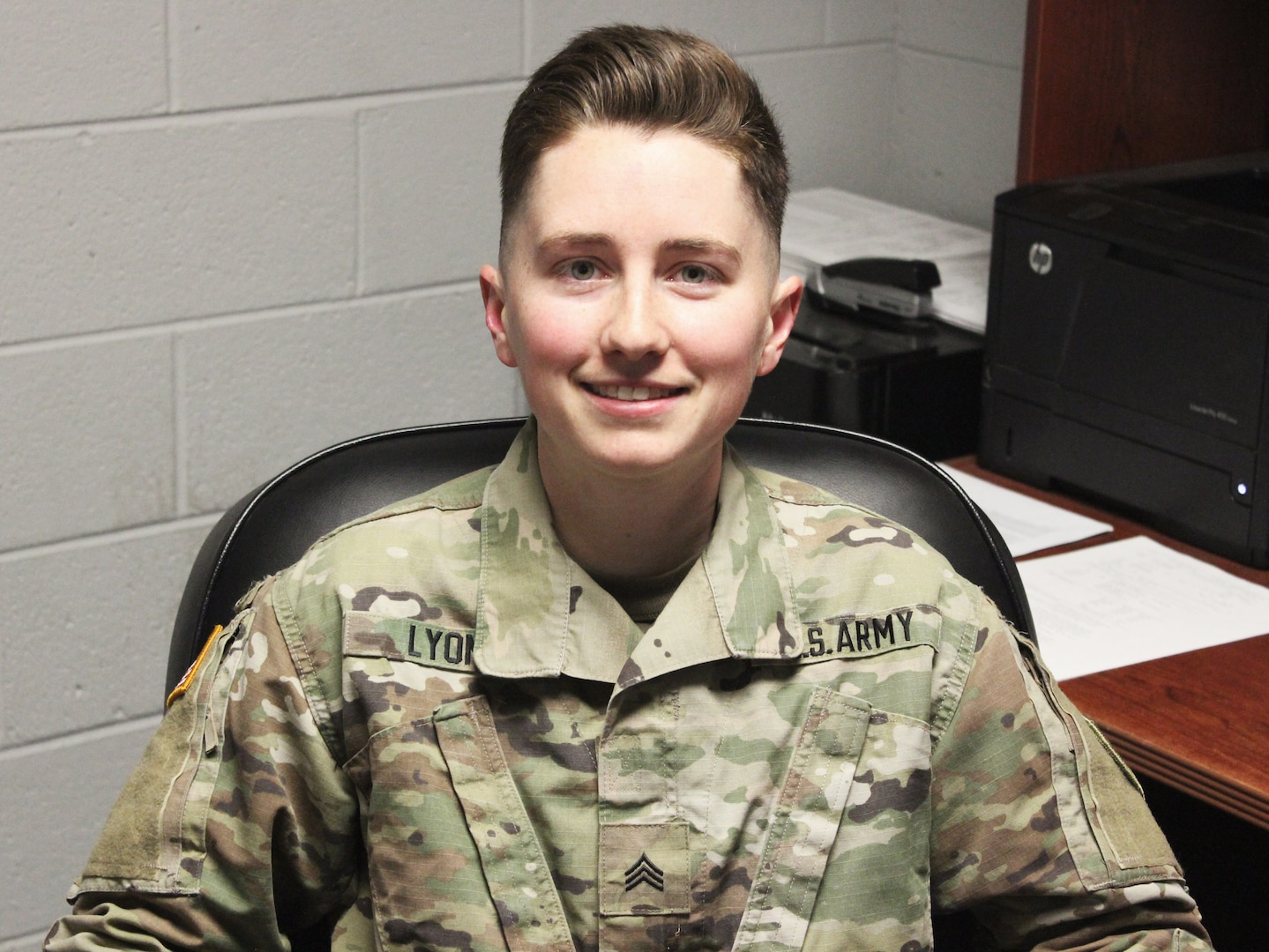 , Sgt. Cassandra Lyons, the supply sergeant for Alpha Company, 229th Brigade Engineer Battalion, 116th Infantry Brigade Combat Team, poses in her office March 2, 2021, in Fredericksburg, Virginia. (U.S. Army National Guard photo by Spc. Holden Russell)