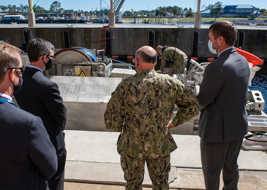 Dr. Peter Adair (far left), technical director at Naval Surface Warfare Center Panama City Division discuss unmanned systems with NSWC PCD engineers Evan McCaw (left), Ricky McNaron (right) , and Adm. Mike Gilday (center), Chief of Naval Operations, March 4.